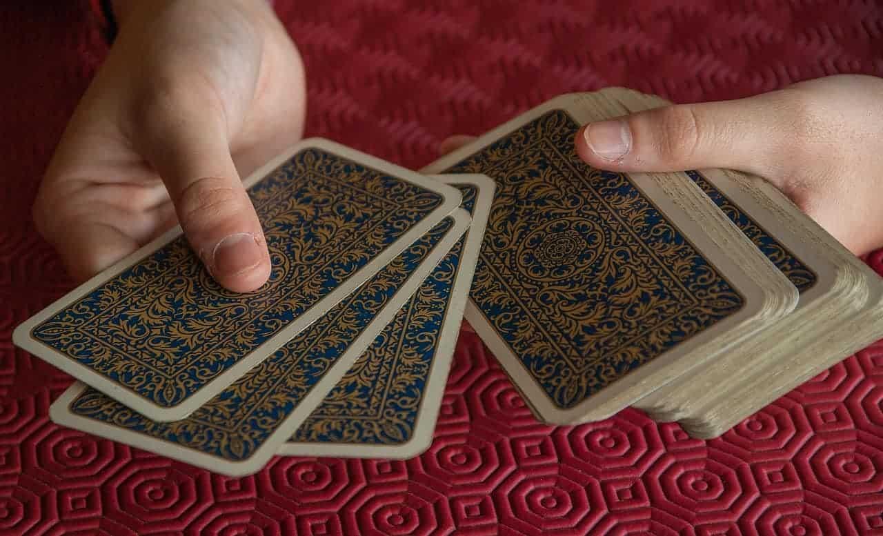 holding tarot cards