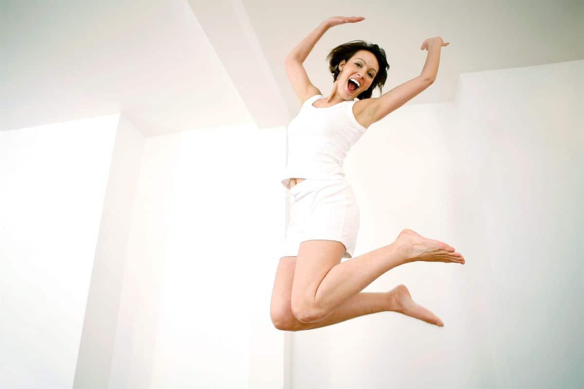 jumping joyful woman