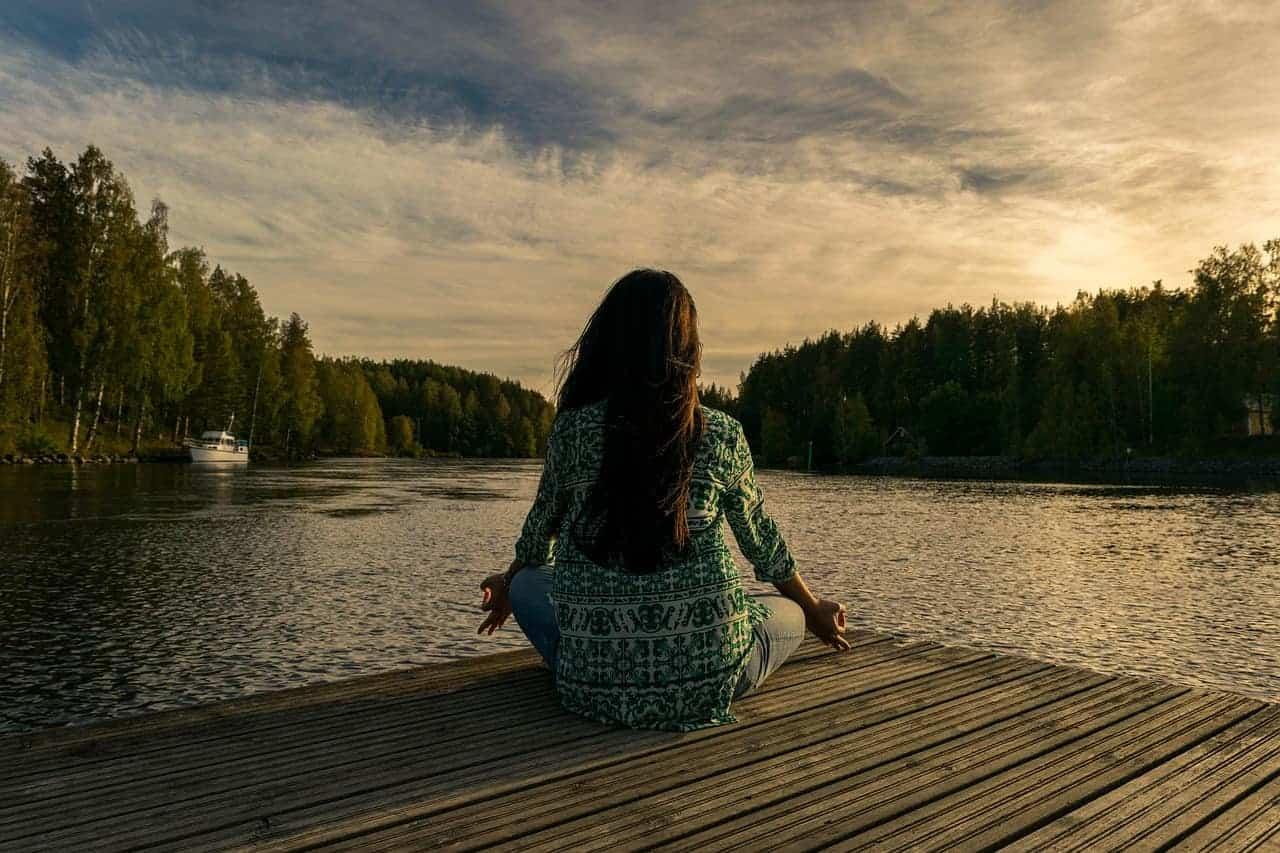 meditating woman trees