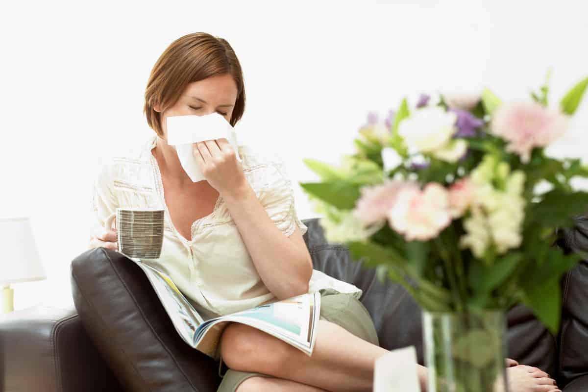flowers woman sneezing