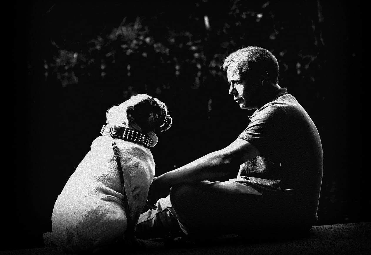man and dog monochrome