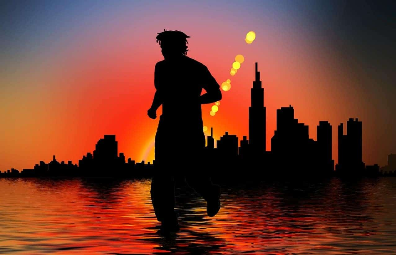 silhouette crossing water