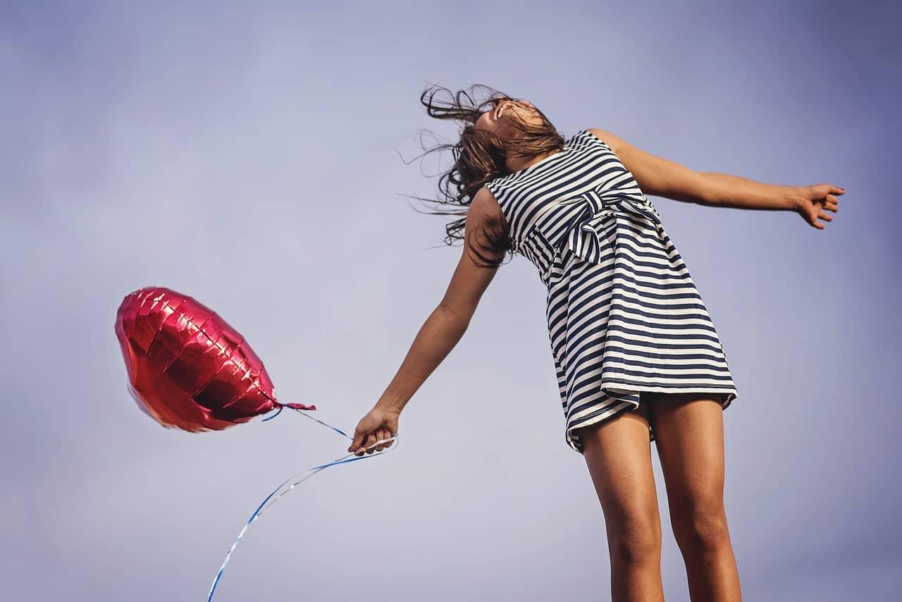 holding balloon letting go