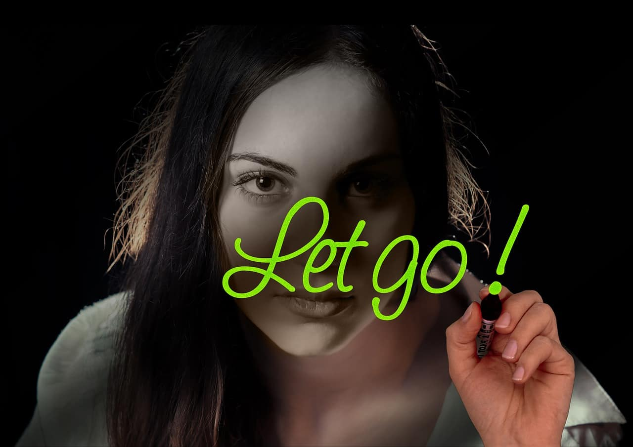 woman writing let go