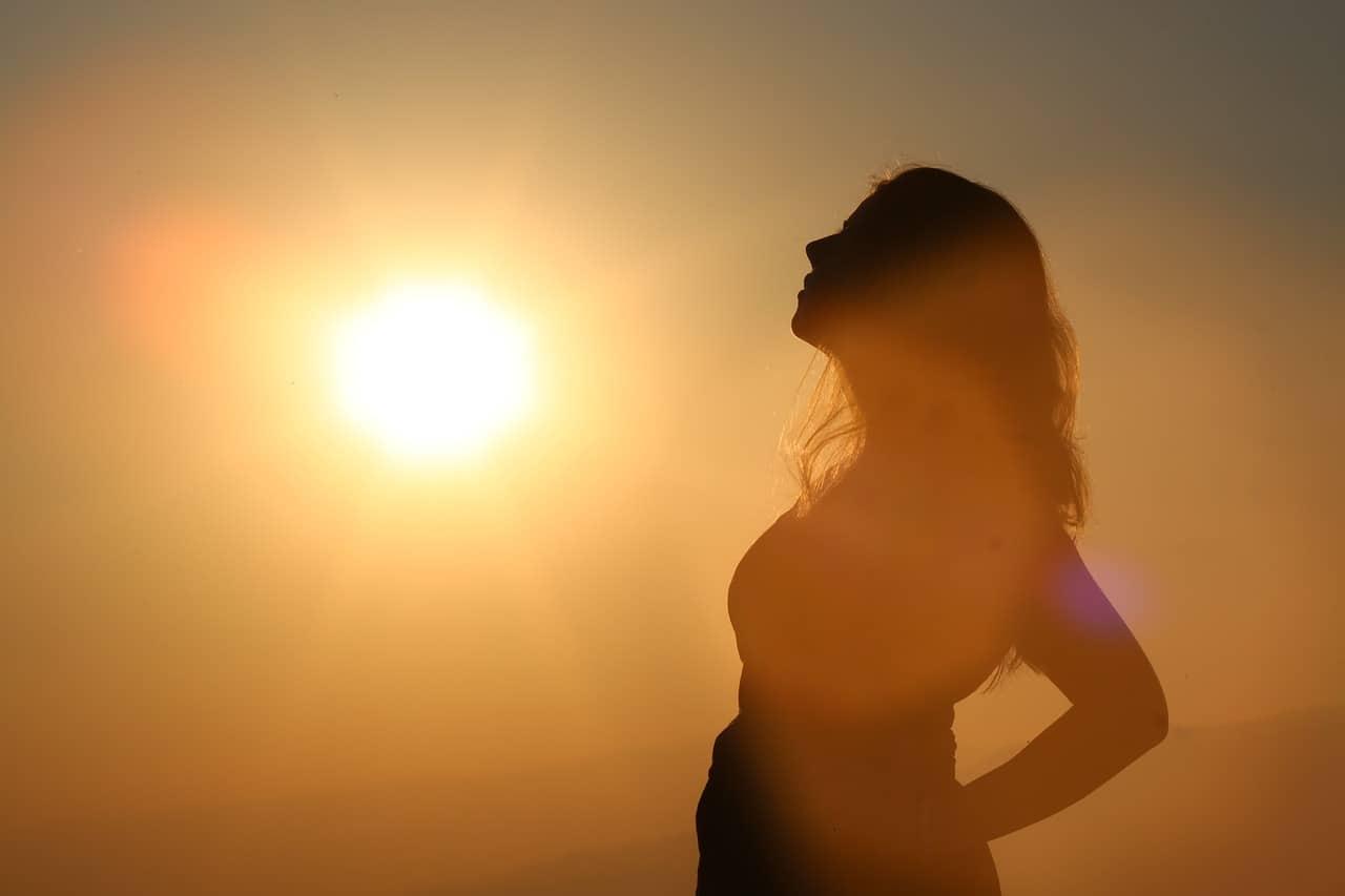 woman contemplating sunrise