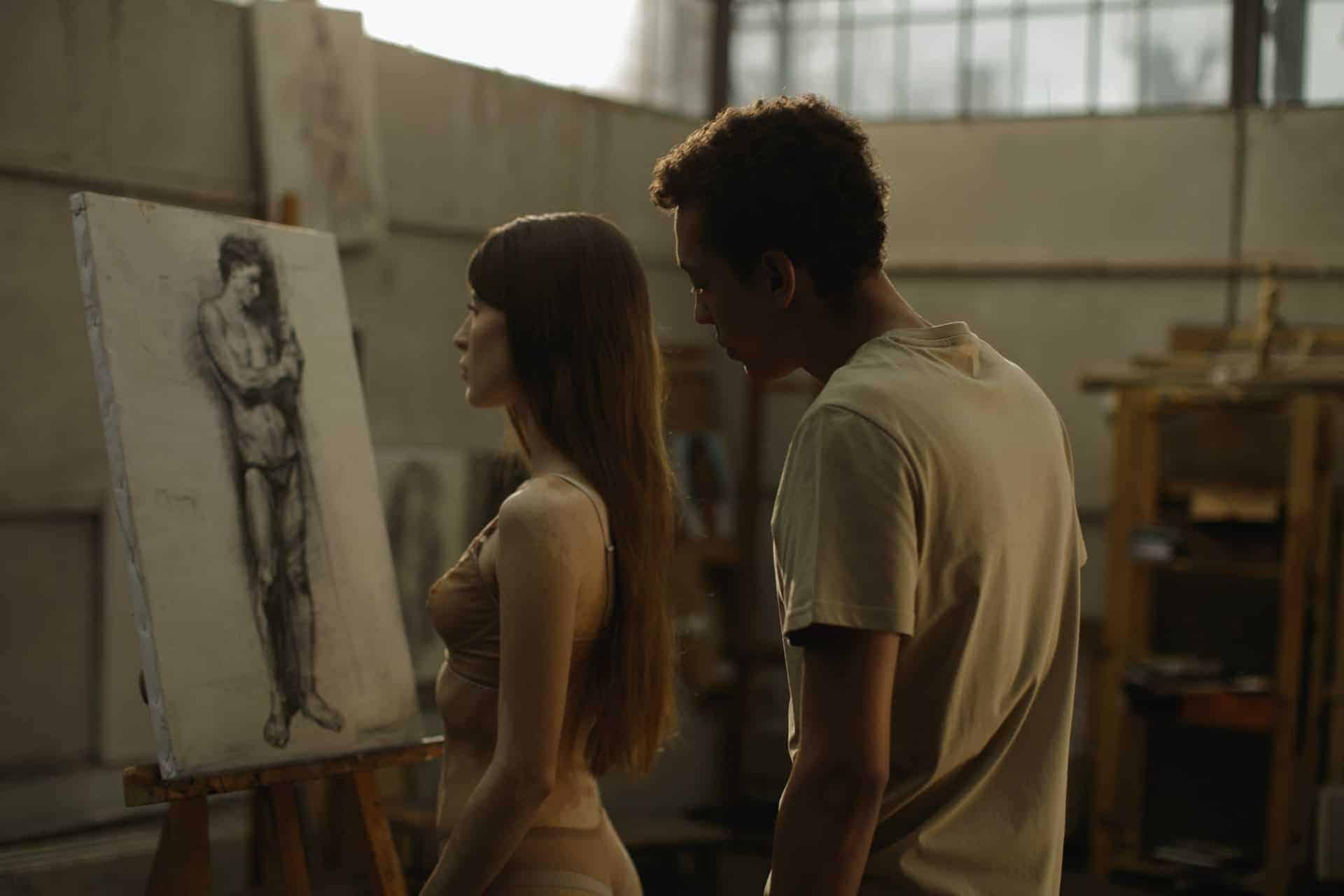 man showing artwork