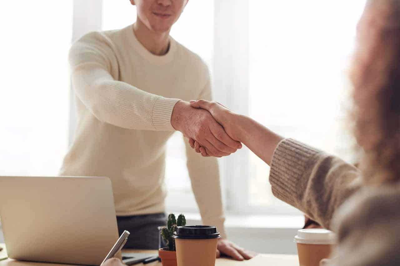 shaking hands new opportunity