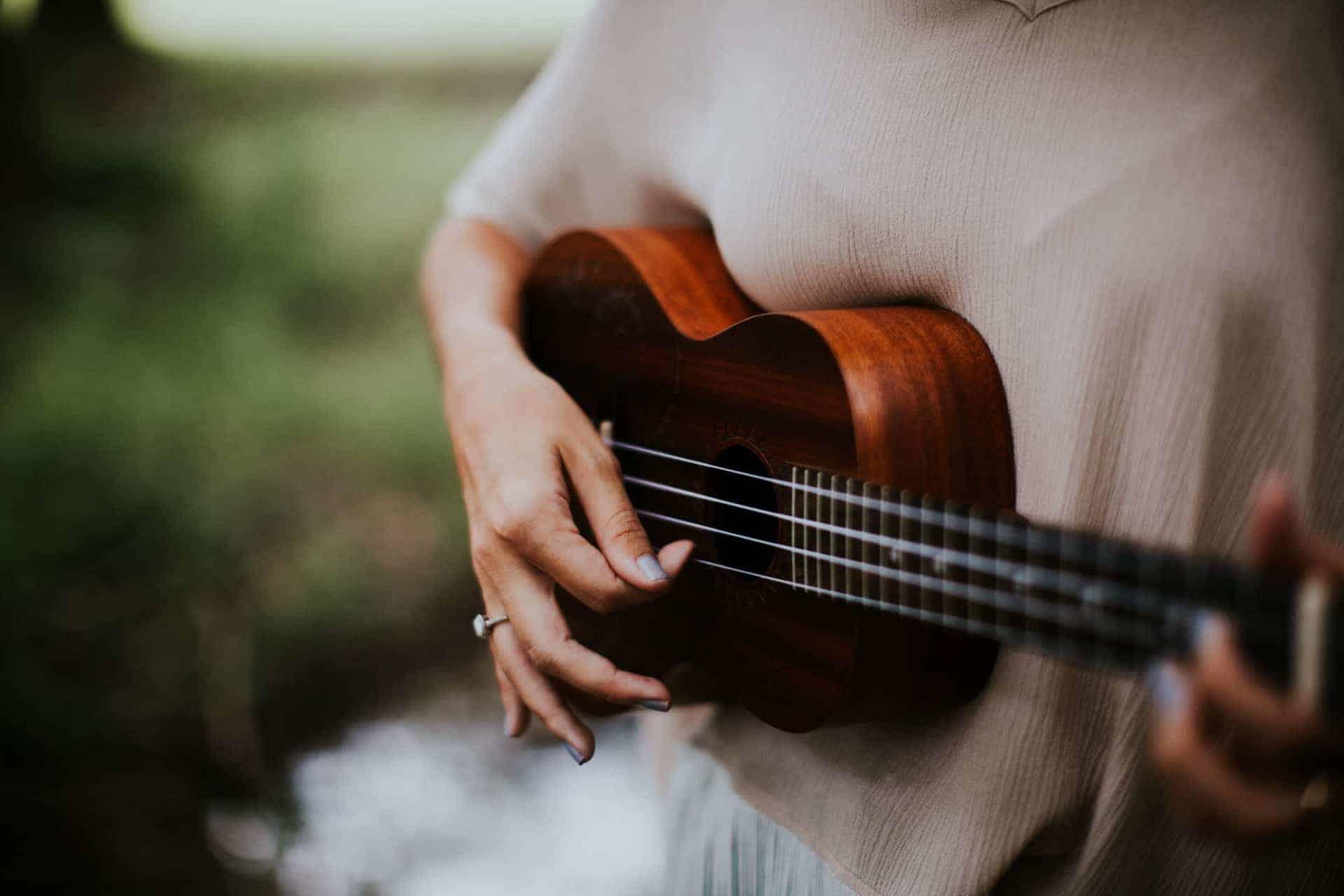 talented woman ukulele