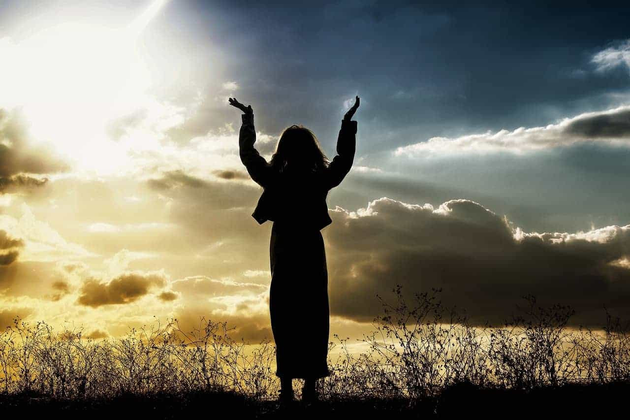 woman praising heavens