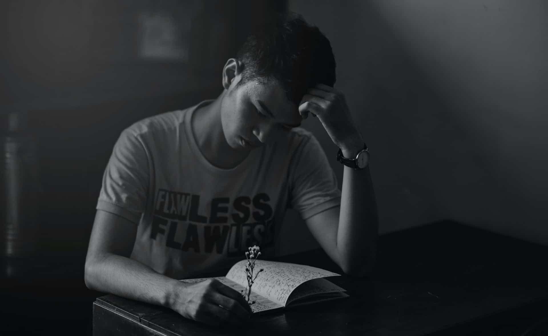 man alone reading