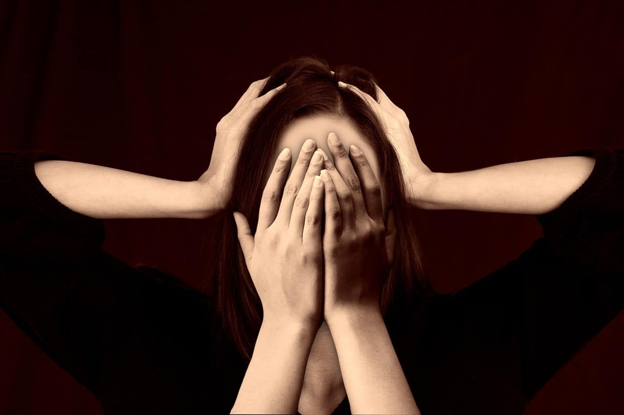 woman covering face
