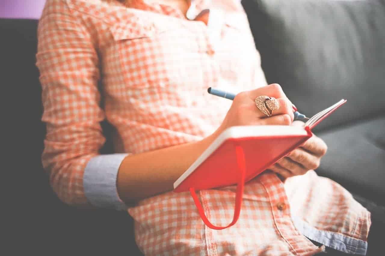 woman writing journal