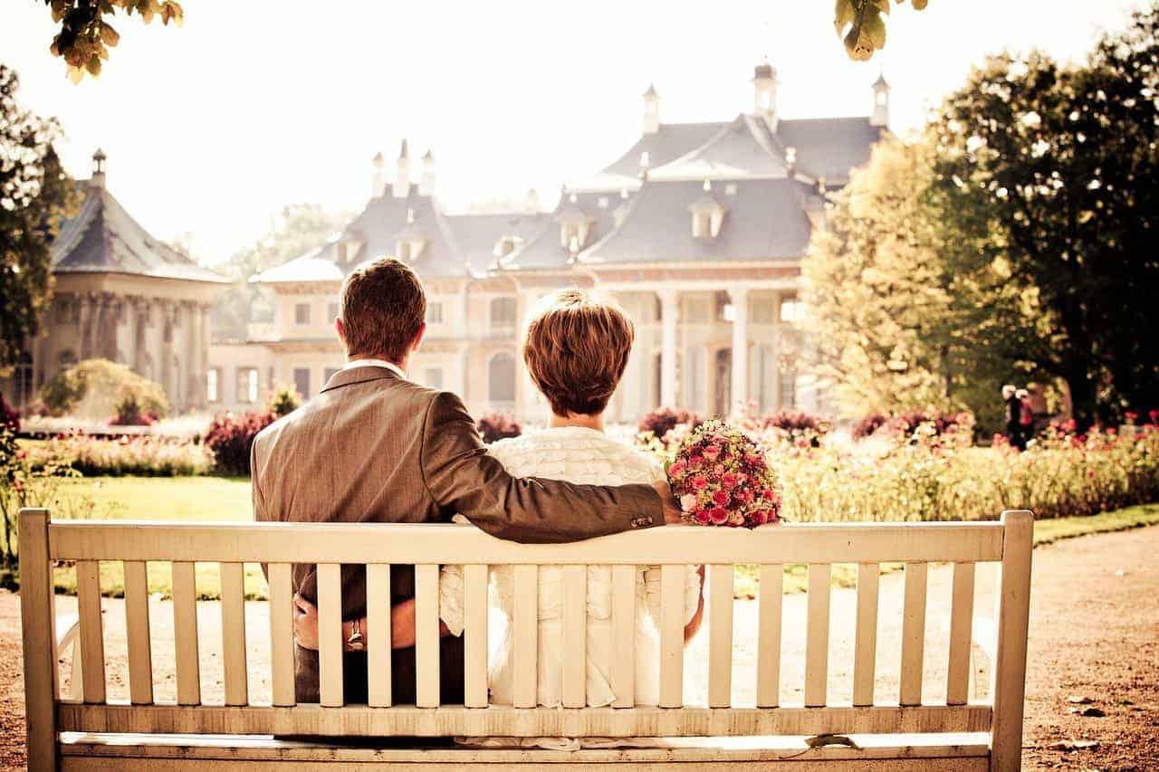 couple sitting bench