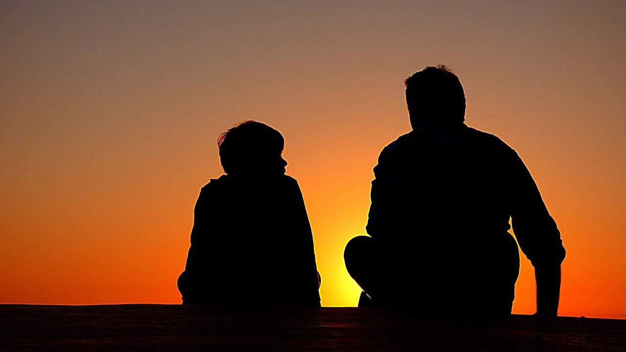 silhouette people sunset