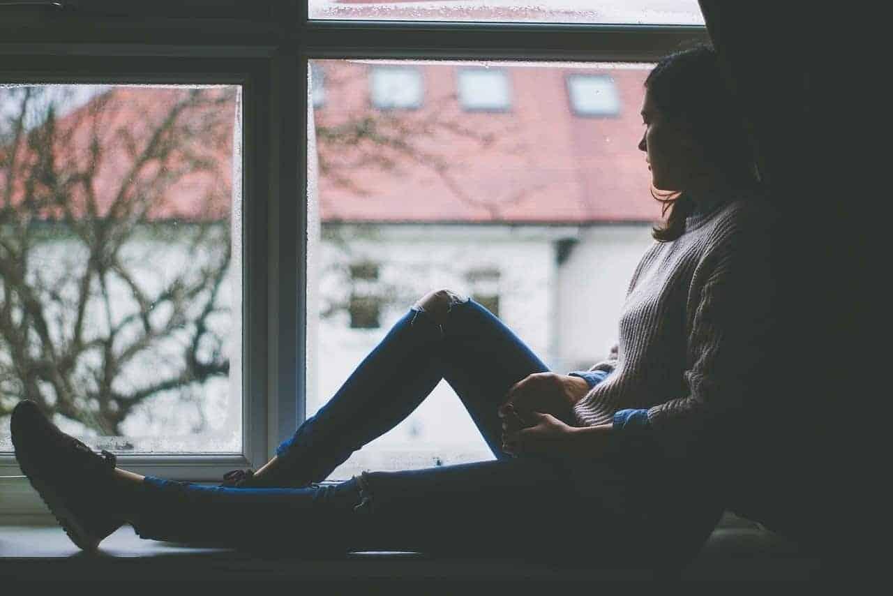 sitting by window