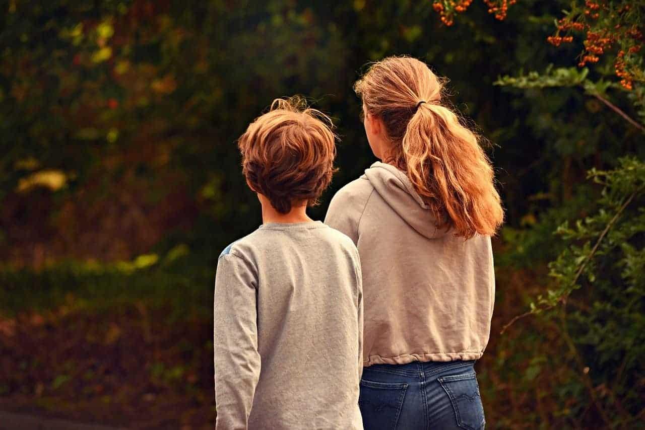 siblings outdoors