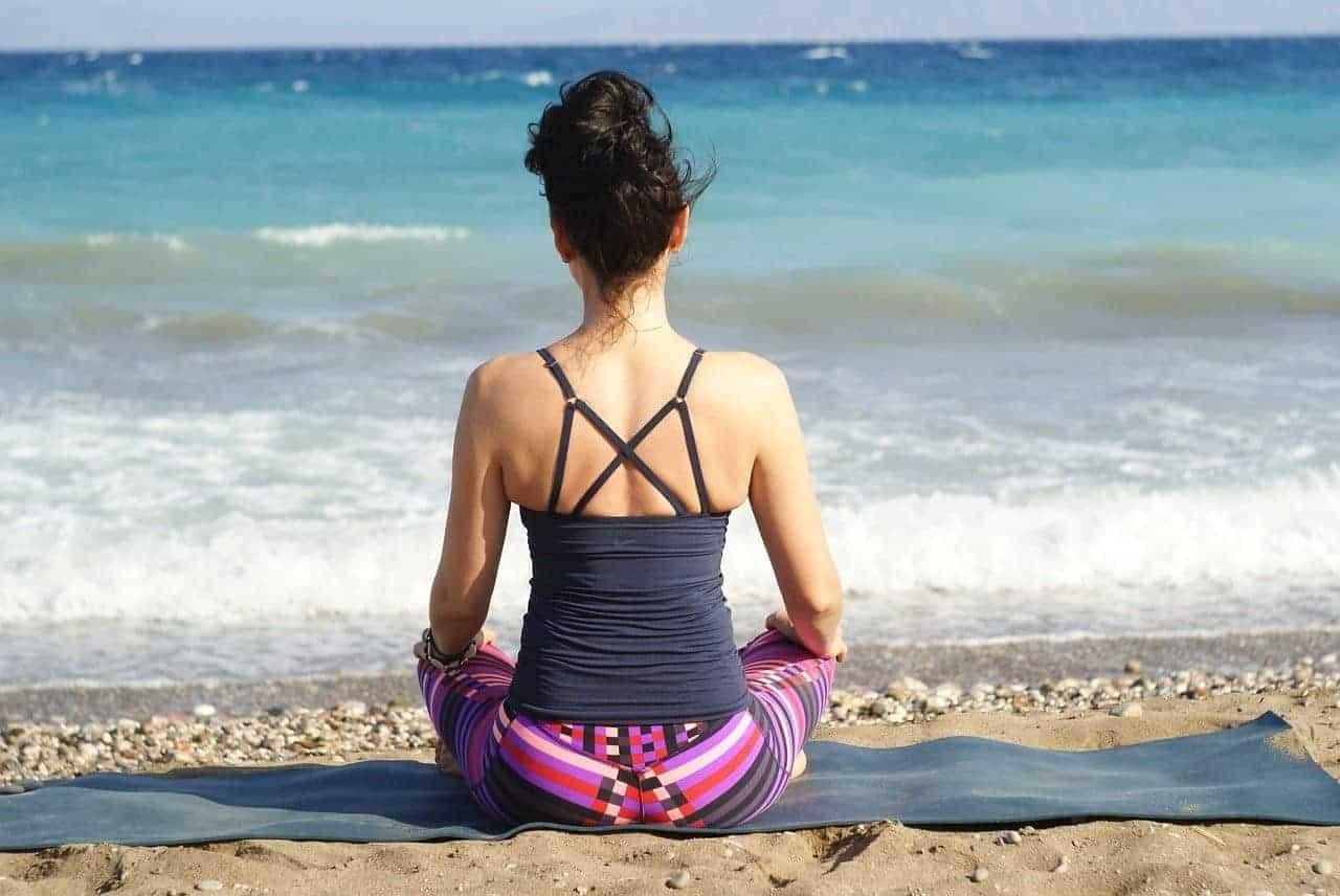 woman meditating ocean