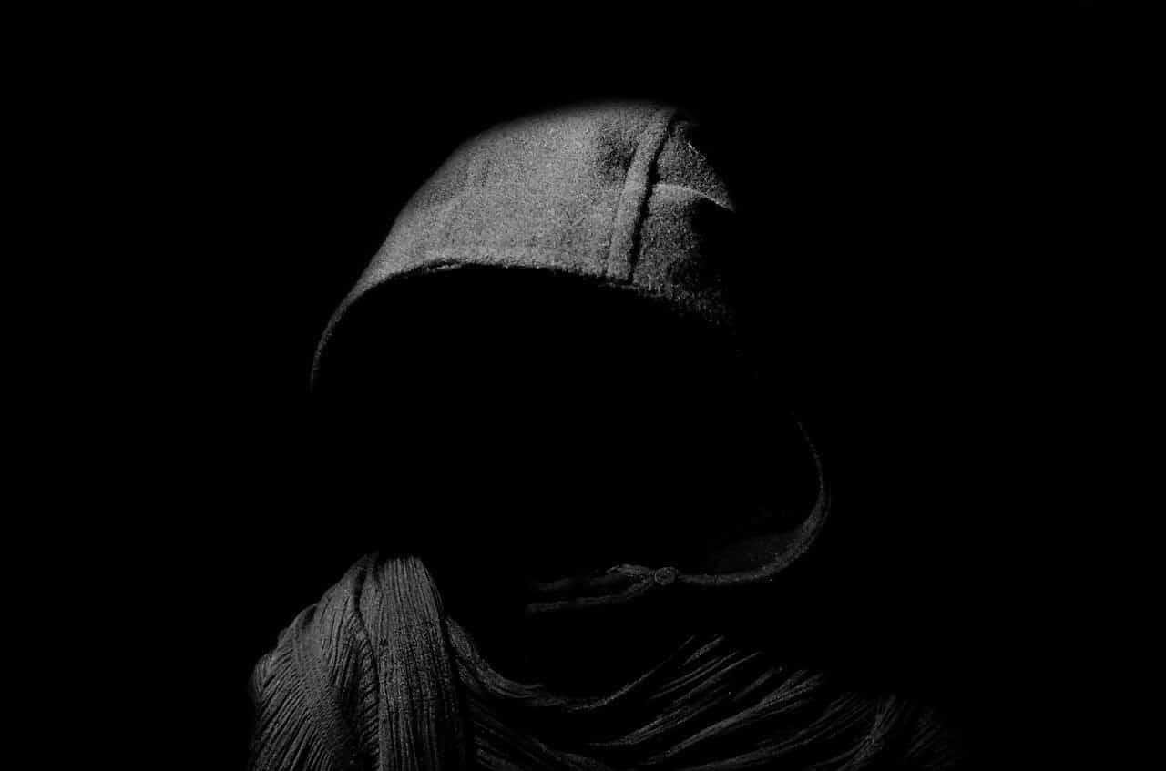 hooded figure dark