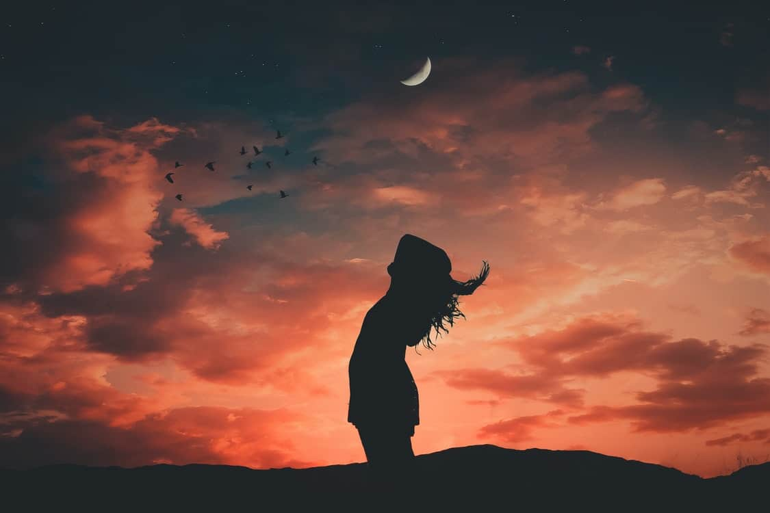 silhouette woman moon
