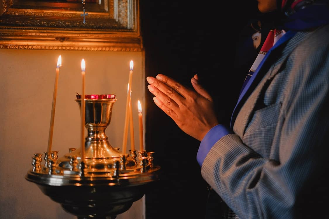 lighting candle church
