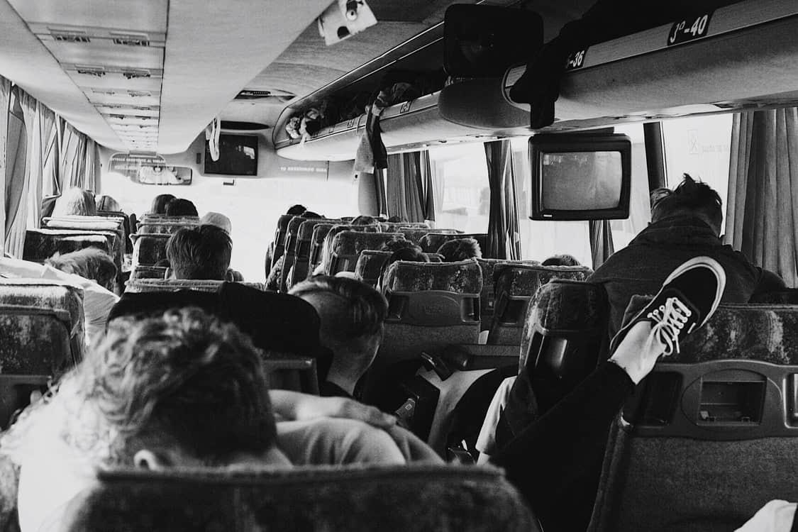 monochrome people bus